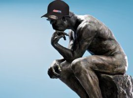 Thinking statue wearing Amsoil Thug Hat