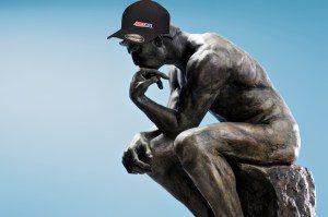 Thinking statue wearing Amsoil Thug Hat